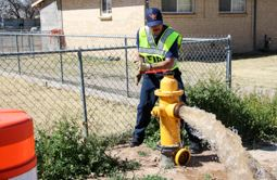 Los Lunas Firefighter Flushing Fire Hydrant